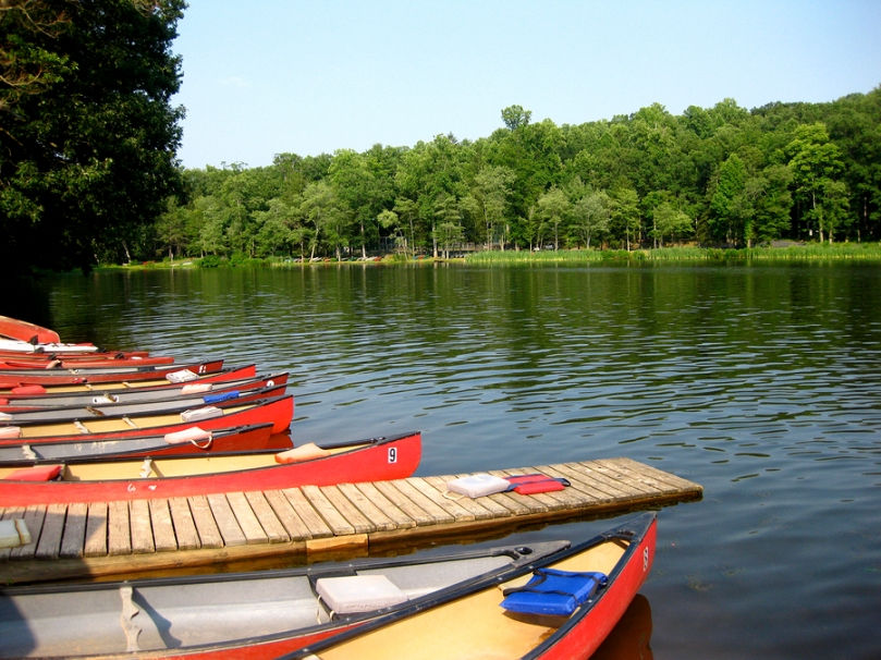 Mt. Gretna Lake with boats lined at a dock