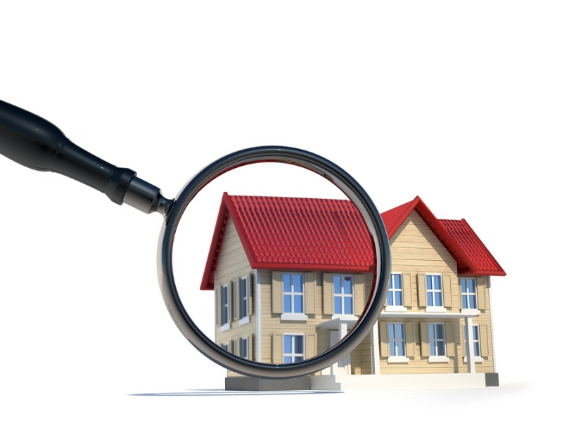 3D image of a home with the left side enlarged beneath a magnifying glass, all on white background