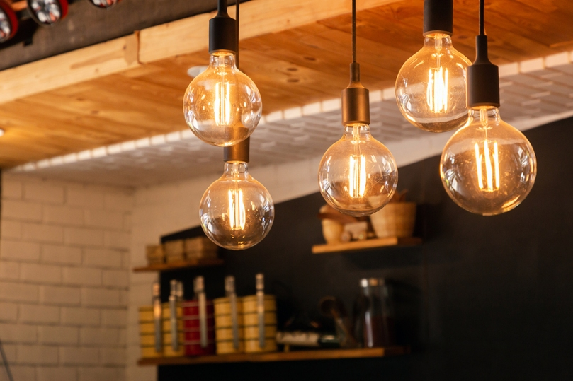 hanging LED lights, vintage style with yellow tint above bar